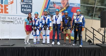 Over the Edge Features VIPs from NASCAR, Charlotte Community Rappelling Over Embassy Suites Charlotte Uptown  To Help Children in the Local Charlotte Community