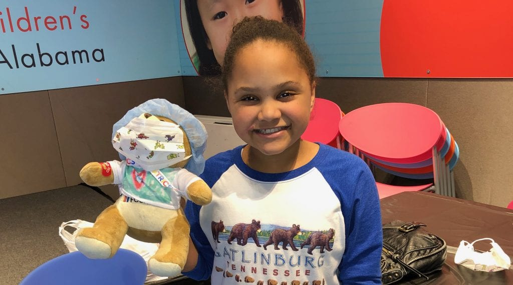 Girl With Her Patched Up Speedy Bear At The Teddy Bear Clinic Courtesy Of Talladega Superspeedway