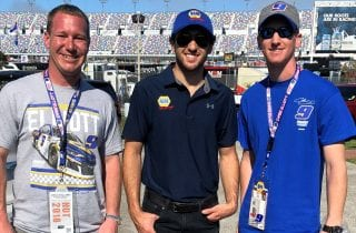 Chase Elliott meets two fans at Daytona International Speedway for the Daytona 500