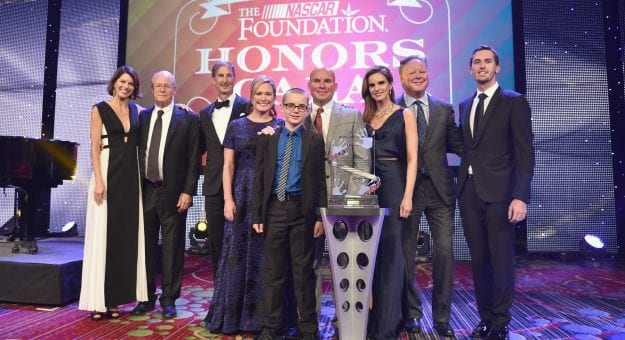 NEW YORK, NY - SEPTEMBER 27:  Jennifer Bates, Lesa France Kennedy, Andy Hoffman, Amy France, Brian France, and Ben Kennedy pose with award onstage during First Annual NASCAR Foundation Honors Gala on September 27, 2016 in New York City.  (Photo by Bryan Bedder/NASCAR via Getty Images)